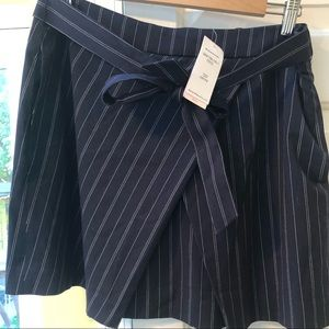 Short navy and white pin stripe skirt with pockets